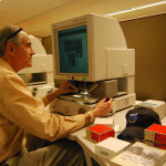 Thomas C. Sanger researching newspaper microfilm, New York Public Library, NYC. (5/2/2012)