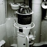 The torpedo firing lever on the bridge of U-995 is located on the right hand side of the boat's aiming column. Special binoculars were attached to the column for U-boat surface attacks. A similar lever is located in the combat center just below the bridge for submerged attacks.